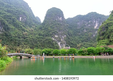 The scenic landscape of limestone mountains at Tam Coc National Park. Tam Coc is a popular tourist destination in Ninh Binh, Vietnam.