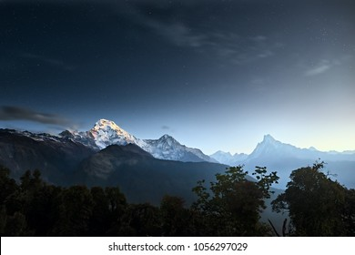 Scenic landscape with mountain range Annapurna and night sky in stars. Himalayas on early morning. Natural mountain background.