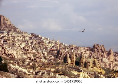 scenic landscape of old town of Cappadocia and flying pigeons in middle east Turkey