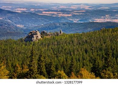 Scenic landscape of rocks and forest in Karkonosze, Poland.