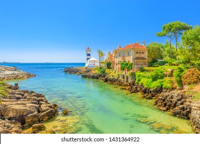 Scenic landscape of Santa Marta Lighthouse or Saint Martha's Lighthouse and House of Saint Mary or Casa de Santa Maria on Tagus River estuary in Cascais, Lisbon Coast, Portugal. Copy space. Blue sky.