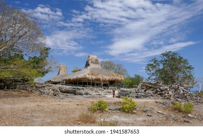 Scenic landscape of traditional houses on stilts with thatched roofs in Prai Ijing village, Sumba island, East Nusa Tenggara, Indonesia