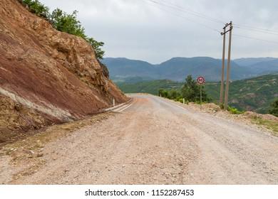 Scenic landscape view in Albanian mountain, gravel road in Deje Mountain.