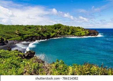 A scenic landscape view of Black Sand Beach on the Hawaiian Island of Maui (State Park of Wai'anapanapa)
