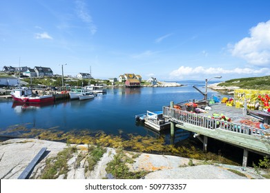 Scenic landscape view of the calm waters of the harbour in the fishing village of Peggy's Cove, in Halifax, Nova Scotia, Canada