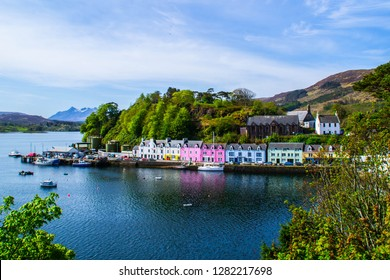 Scenic landscape view of colorful buildings/houses in harbour of Portree town on Isle Of Skye in Scotland, United Kingdom. Popular tourist attraction/destination in Europe. Summer active holiday.