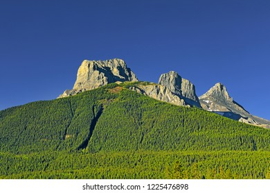 Scenic Landscape View of Kananaskis, Three Sisters Mountain peaks, Mountain in the Canadian Rockies, Alberta, Canada