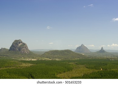 Scenic landscape view of the lush green surroundings and topography of Glass House Mountains on the Sunshine Coast, Queensland , Australia on a sunny blue sky day in a travel concept