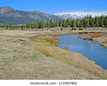 Scenic landscape view of a meadow, river and Sierra Mountains from a valley in the Carson Pass.