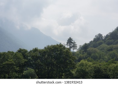 Scenic landscape view of mountains and cloudy sky in Japan.