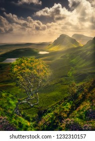 Scenic landscape view of Quiraing mountains in Isle of Skye with sunrays, Scottish highlands, United Kingdom