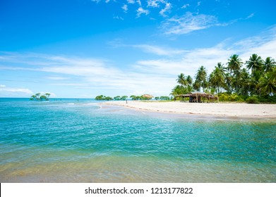 Scenic landscape view of rustic beach bar on empty tropical beach on a remote island in northeast Bahia, Brazil