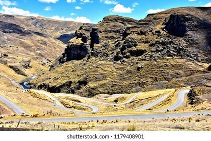 Scenic local road cutting through rural mountainous (Andes) landscape. Peru.