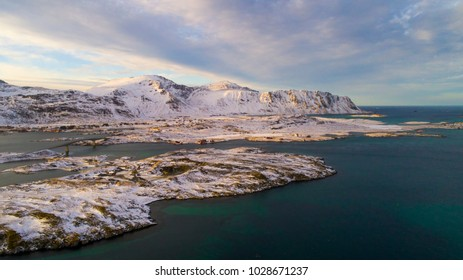 Scenic Lofoten Islands in the winter, with green blue ocean