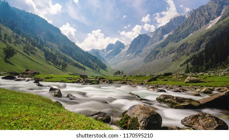 Scenic long exposure water flowing in river with mountain landscape in Sonamarg, Jammu and Kashmir, India