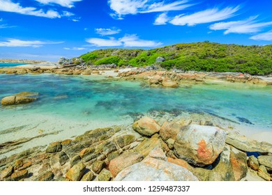 Scenic Madfish Island has the best William Bay rock pools. William Bay NP, Albany region, Western Australia. Sunny day with blue sky. Popular summer destination in Australia.