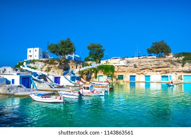 Scenic Mandrakia village (traditional Greek village by the sea, the Cycladic-style) with sirmata - traditional fishermen's houses, Milos island, Cyclades, Greece.