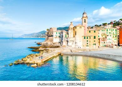 Scenic Mediterranean riviera coast. Panoramic view of Camogli town in Liguria, Italy. Basilica of Santa Maria Assunta and colorful palaces. Liguria, Italy