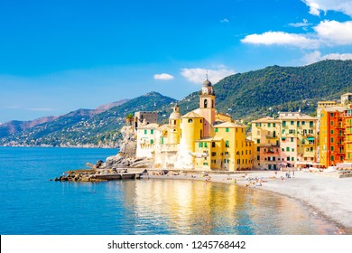 Scenic Mediterranean riviera coast. Panoramic view of Camogli town in Liguria, Italy. Basilica of Santa Maria Assunta and colorful palaces. Liguria, Italy
