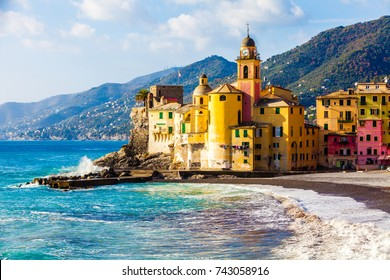 Scenic Mediterranean riviera coast. Panoramic view of Camogli town in Liguria, Italy. Basilica of Santa Maria Assunta and colorful palaces.