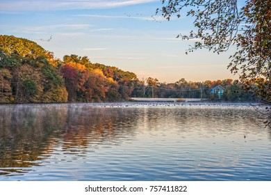 Scenic Millhurst Pond on an early Autumn morning in Thompson Grove Park in Manalapan New Jersey.