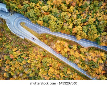 Scenic Mohawk Trail highway hairpin turn in autumn, Massachusetts, USA. Fall in New England. Aerial drone shot.