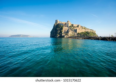 Scenic morning view of the dramatic Aragonese Castle looming from its ancient mountaintop perch above the Mediterranean island of Ischia, Italy