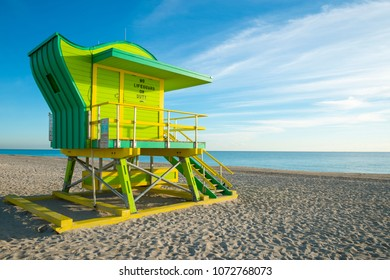 Scenic morning view of an iconic lifeguard tower in bright pastel colors on South Beach, Miami