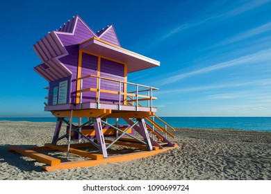 Scenic morning view of an iconic purple and orange lifeguard tower on South Beach, Miami