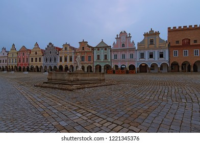 Scenic morning view of main square in medieval Telc. Fountain with statue of st. Margaret and colorful vintage buildings. A UNESCO world heritage site. Telc, Czech Republic.