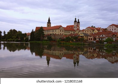 Scenic morning view of medieval Telc at sunrise. Buildings are reflected in the water. Famous touristic place and travel destination in Europe. A UNESCO World Heritage Site. Telc, Czech Republic.