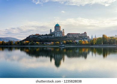 Scenic morning view on Basilica of the Blessed Virgin Mary and Royal Castle in Esztergom, Hungary with reflection in the water over the Danube River from Sturovo, Slovakia.