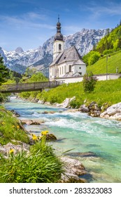 Scenic mountain landscape in the Bavarian Alps with famous Parish Church of St. Sebastian in the village of Ramsau in springtime, Nationalpark Berchtesgadener Land, Upper Bavaria, Germany