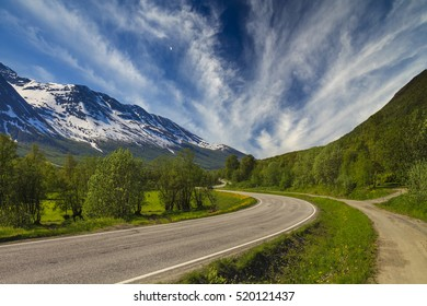 Scenic mountain landscape with road and cloudy sky