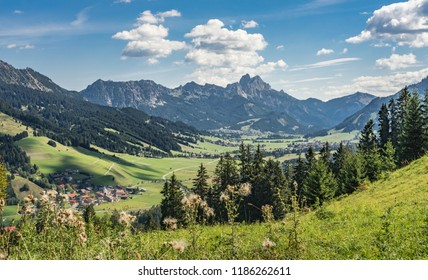 scenic mountain landscape in the Tannheim Valley, Tirol, Austria with the famous summits of Rote Flueh, Gimpel and Aggenstein