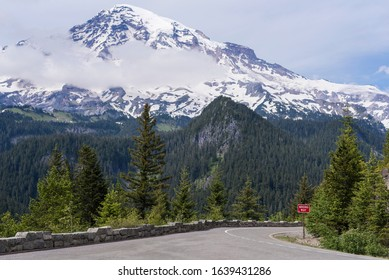 Scenic mountainous road with bright red wrong way sign