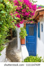 Scenic narrow street with old house in Anafiotika in Plaka district, Athens, Greece. Plaka is one of the main tourist attractions of Athens. Beautiful traditional alley at Acropolis slope in Athens.