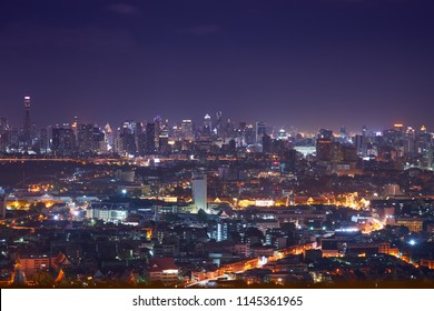 scenic of night cityscape with light tail speed line in metropolis