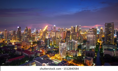 scenic of night cityscape lighting up and twilight skyline in metropolis