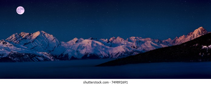 Scenic night panorama sunset landscape of Crans-Montana range in Swiss Alps mountains with peak in background, Crans Montana, Switzerland.