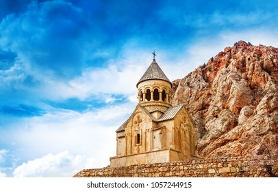 Scenic Novarank monastery in Armenia. against dramatic sky. Noravank monastery was founded in 1205. It`s located 122 km from Yerevan in  narrow gorge made by Darichay river nearby city of Yeghegnadzor