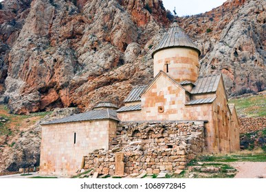 Scenic Novarank monastery in Armenia. Noravank monastery was founded in 1205. It is located 122 km from Yerevan in a narrow gorge made by the Darichay river nearby the city of Yeghegnadzor