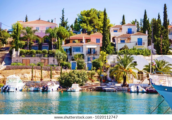 Scenic in the old harbor of Spetses island, Greece, with fishing boats and beautiful mansions, September 24 2015.