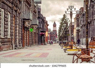 Scenic old paving street with church on the background in the historic Gyumri city in Armenia