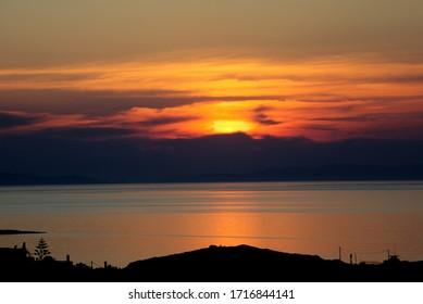 Scenic orange sunset at blue hour. Stock Image.