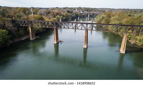 Scenic Outdoor Daytime Aerial Drone Landscape Photographic Image Rust Covered Old Antique Vintage Steel Railroad Train Track Trestle Crossing Historic Potomac River in Maryland, USA