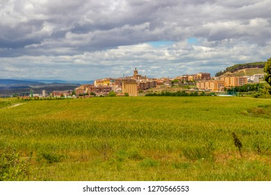 Scenic overcast view of Viana in Navarre, Spain on the Way of St. James with wheat field in the foreground