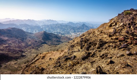 Scenic overlook of Al Hajar mountains in the emirate of Fujairah, UAE and a village in a valley