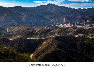 Scenic overlook of Calabasas with the Santa Monica Mountains in the background on a sunny day with blue sky and clouds, Calabasas Peak State Park, Calabasas, California