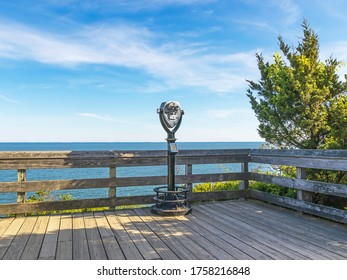 Scenic overlook of ocean with viewfinder on wooden deck at Hammonasset Beach, Madison, CT.